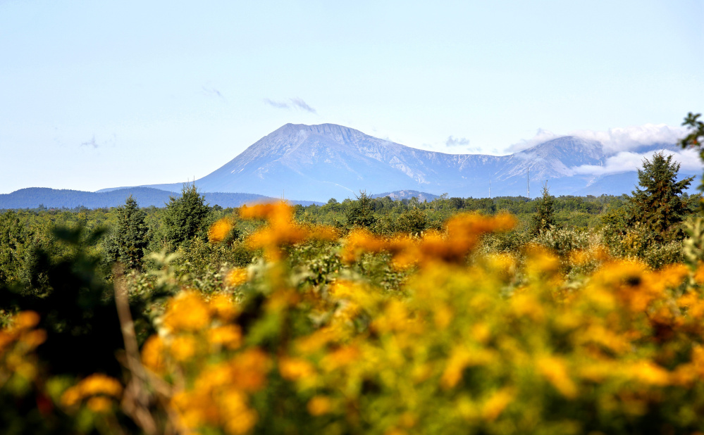 Mount Katahdin is seen from Route 159 in Patten, bordering the Katahdin Woods and Waters National Monument. President Trump's move to review the designation has cast a pall over its immediate success.