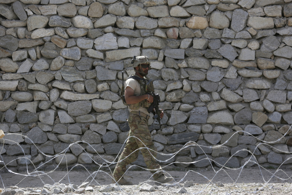 A U.S. soldier patrols near the site of a bombing in Jalalabad, east of Kabul, Afghanistan, in April. The Trump administration is considering sending more troops to Afghanistan as prospects are narrowing for a negotiated peace settlement with the Taliban.