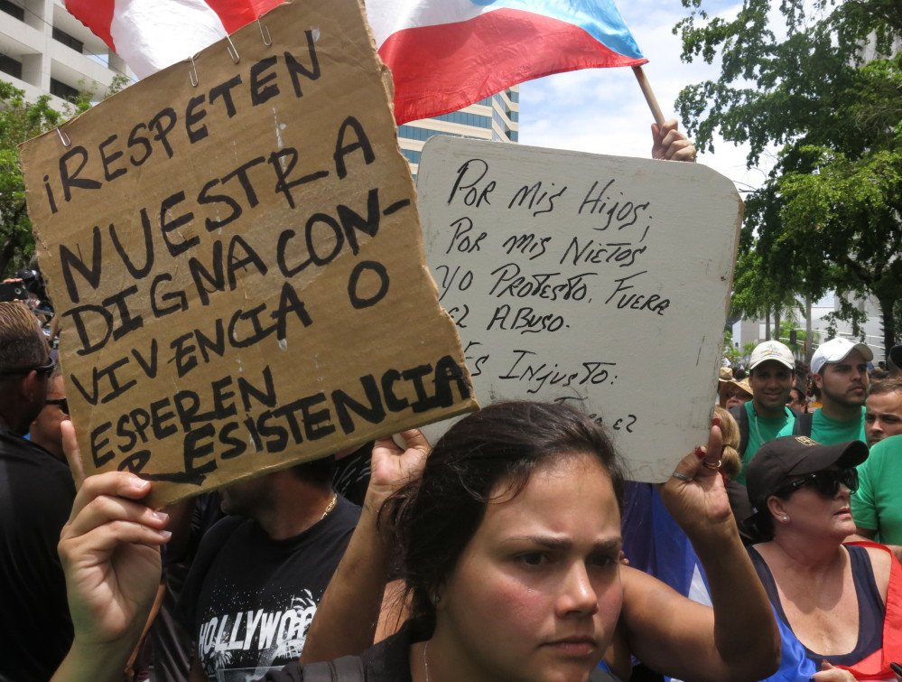 Demonstrators protest looming austerity measures amid an economic crisis and demand an audit on the island's debt to identify those responsible during the May Day march in San Juan, Puerto Rico, last week.