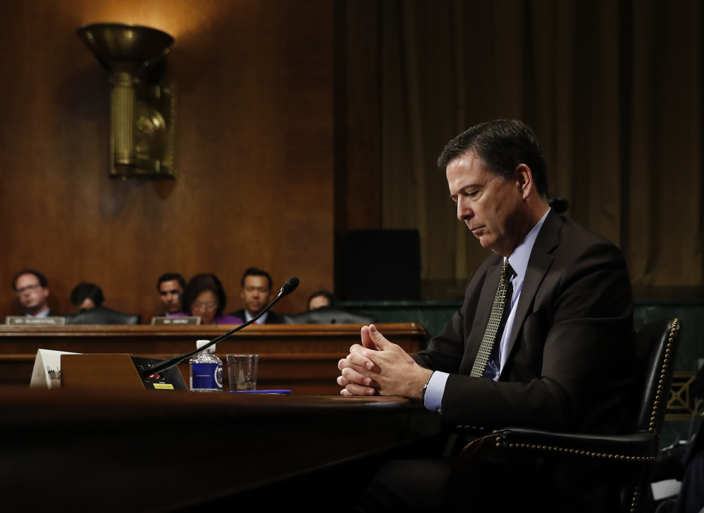James Comey pauses as he testifies May 3 before the Senate Judiciary Committee. President Trump abruptly fired Comey last week, ousting the nation's top law enforcement official in the midst of an investigation into whether Trump's campaign had ties to Russia's election meddling.