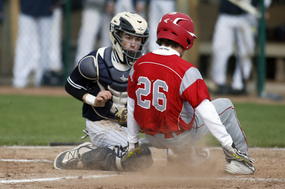 Portland catcher Cam King makes the play at home, tagging out South Portland's Gordon Whittemore in the fourth inning of Tuesday's game at South Portand.