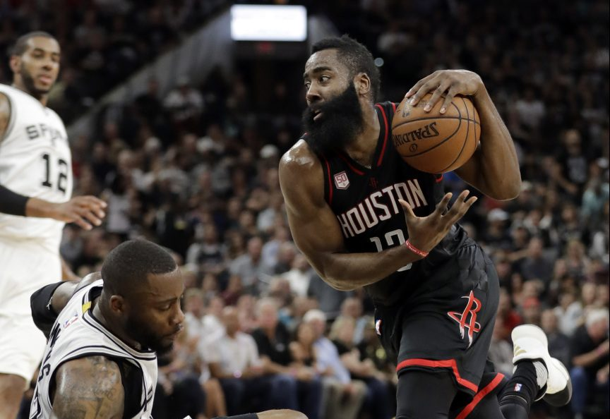 James Harden of the Houston Rockets heads to the basket as Jonathon Simmons of the San Antonio Spurs heads to the floor Tuesday during San Antonio's 110-107 overtime victory.