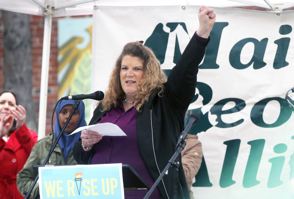 Sandra Scribner Merlim, whose husband, Otto Morales-Caballeros, was deported Thursday, speaks at a rally for immigrants May 1 at Congress Square Park in Portland.