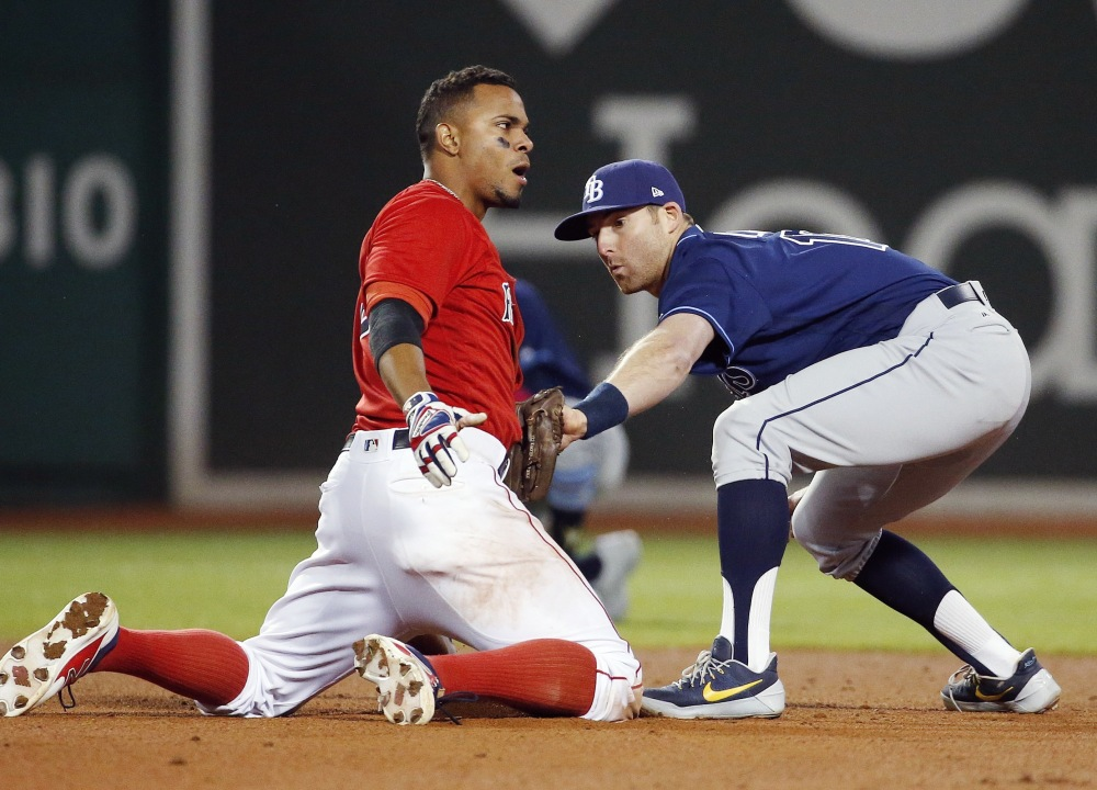 Boston's Xander Bogaerts slides in safely ahead of a tag by Tampa Bay's Brad Miller after hitting a double in the eighth inning Friday night at Boston.