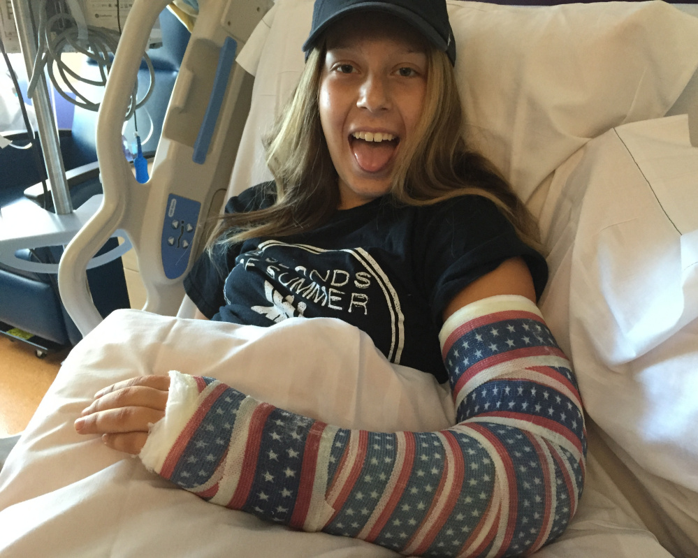 Sydney Waitt's cancer treatments included surgery to remove two-thirds of the radius in her left arm, which meant she had to learn to write right-handed.