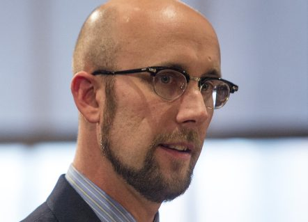 """Jason Shedlock, assistant to the mayor, speaks to the council before its vote terminating his position this month. He said that listening to people talk about him was like """"watching your own funeral."""""""