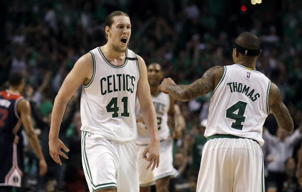 Celtics center Kelly Olynyk celebrates his basket with Isaiah Thomas in the fourth quarter, when Olynyk went on a tear to help the Celtics win. Olynyk finished with 26 points.