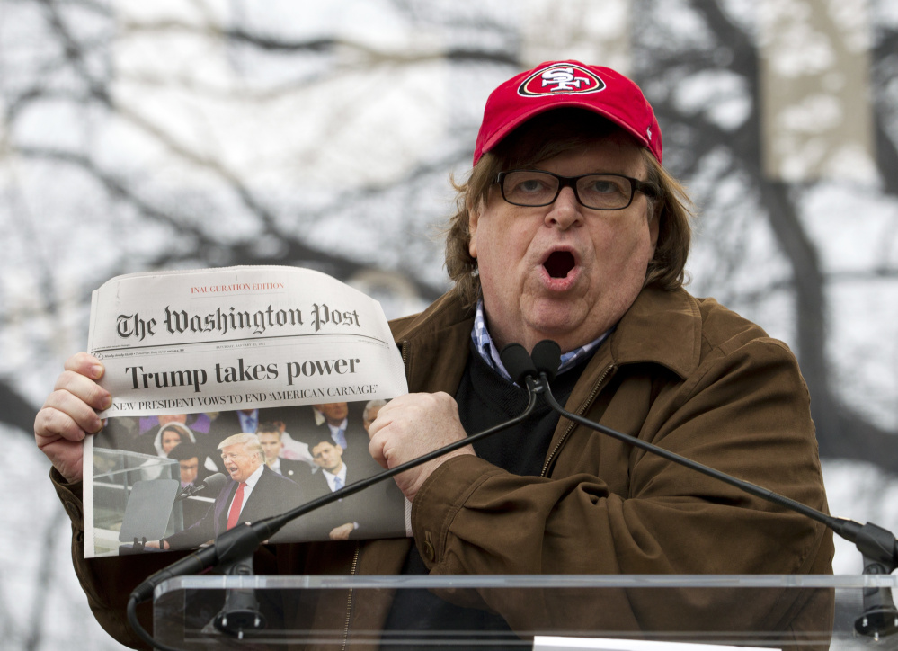 Film director Michael Moore speaks during the Women's March rally Jan. 21 in Washington. He says his upcoming documentary about President Trump will be explosive.