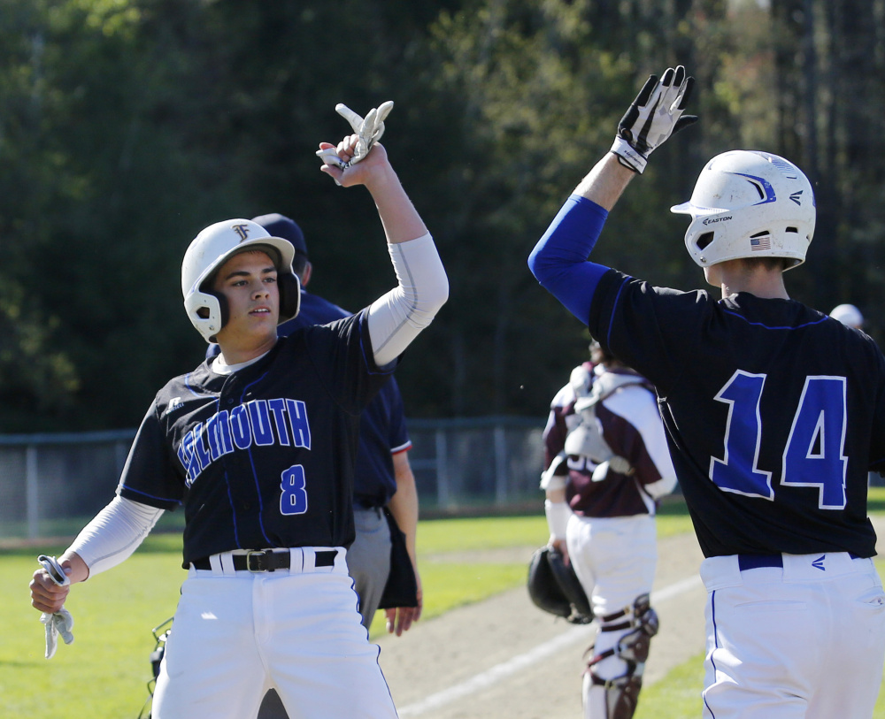 Falmouth's Garrett Aube celebrates with Robbie Armitage after scoring a run in the third inning. The Yachtsmen scored three times in the inning and won 4-0.