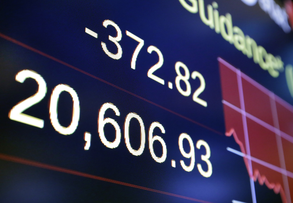 Associated Press/Richard Drew A board above the floor of the New York Stock Exchange shows the closing number for the Dow Jones industrial average on Wednesday. Stocks fell sharply as investors worried that the latest turmoil in Washington could hinder President Donald Trump's pro-business agenda.