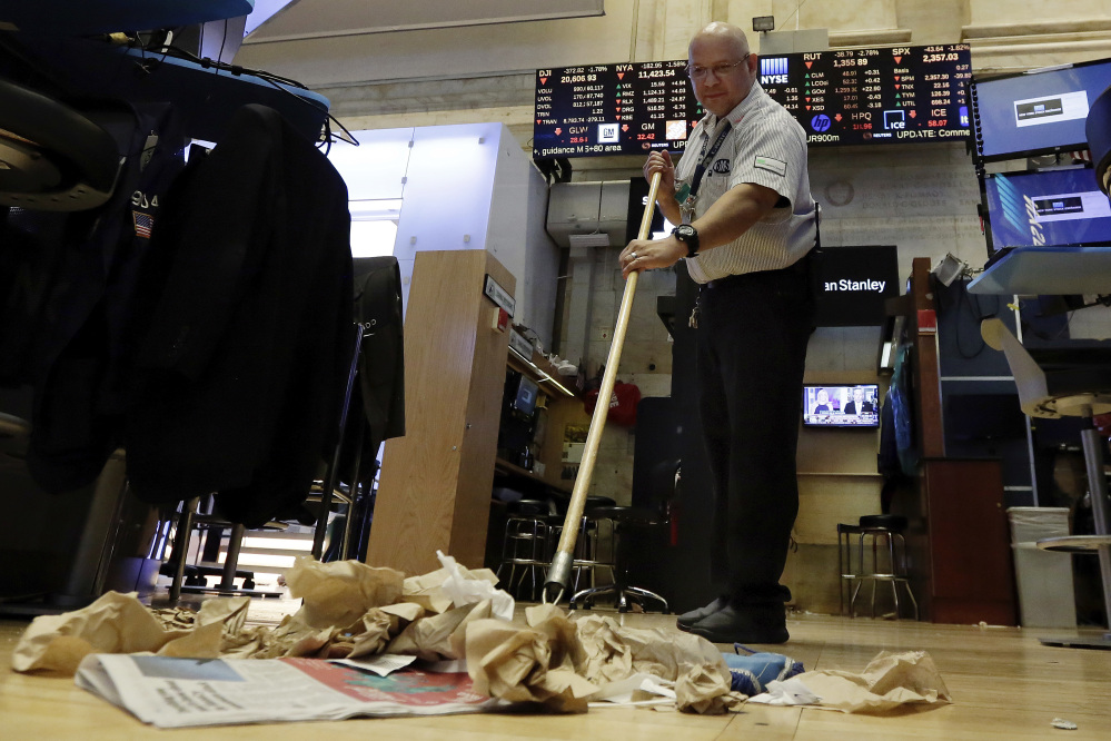 Raul Rodriguez sweeps the trading floor after the closing bell of the New York Stock Exchange on Wednesday. The steep drop Wednesday was the market's worst since September and ended an unusually long period of calm.