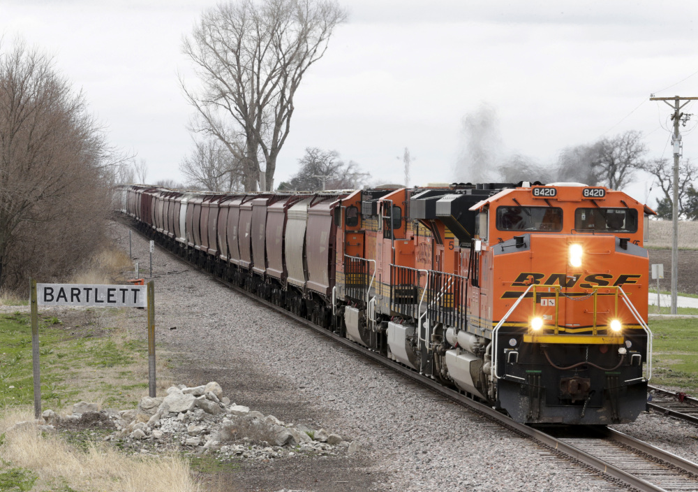 A BNSF Railway train transports grain through Bartlett, Iowa, last month. In 2016, the U.S. ran a more than $20 billion trade surplus in agricultural products. President Trump has vowed to redo the North American Free Trade Agreement, but NAFTA has widened access to Mexican and Canadian markets, boosting U.S. farm exports.