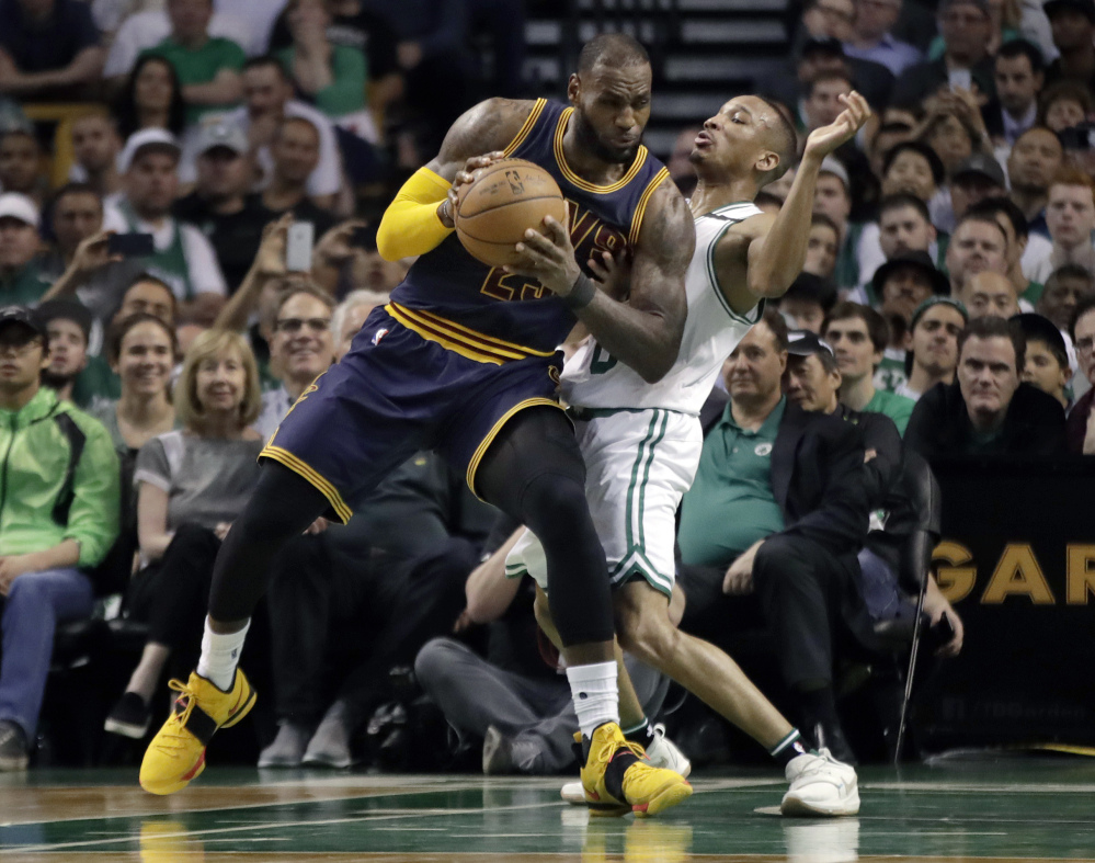 Boston's Avery Bradley, left, and Marcus Smart watch from the bench during the second half Friday night.