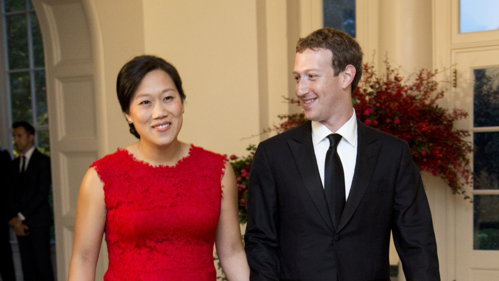 Facebook Chairman and Chief Executive Officer Mark Zuckerberg and his wife, Priscilla Chan, arrive for a state dinner in the East Room of the White House in 2015.