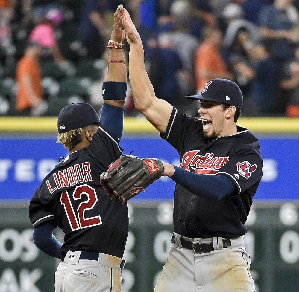 Francisco Lindor, left, and Bradley Zimmer of the Cleveland Indians celebrate Saturday after the 3-0 victory against the Houston Astros.