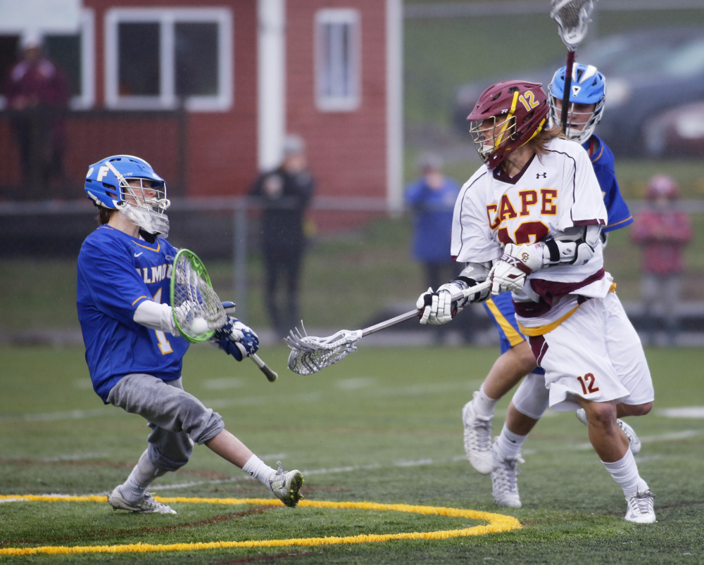 Liam Tucker of Falmouth makes a save on a backhand shot by Owen Thoreck of Cape Elizabeth on April 25.