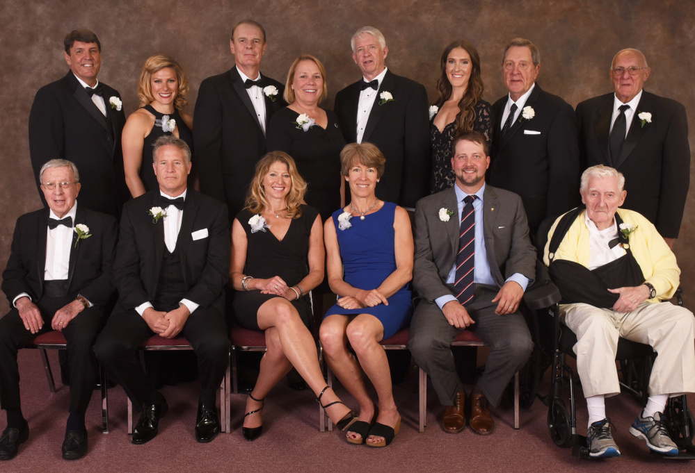 The Maine Sports Hall of Fame inducted its 2017 class at Merrill Auditorium in Portland on Sunday. The 13 inductees, from left to right: Front row – Tom Reynolds (ski coaching), Brett Brown (basketball), Angela Bancroft (triathlon), Leslie Bancroft (Nordic skiing), Ian Crocker (swimming) and Bob Bahre (auto racing). Back row – Jay Hutchins (soccer), Anna Willard (track and field), Kyle Hutchins (soccer), Dan Burke (Sea Dogs founder, represented by his daughter, Sally McNamara), Dick Capp (football), Sarah Marshall Ryan (basketball), Norm Gagne (hockey) and Glenn Hutchins (soccer).