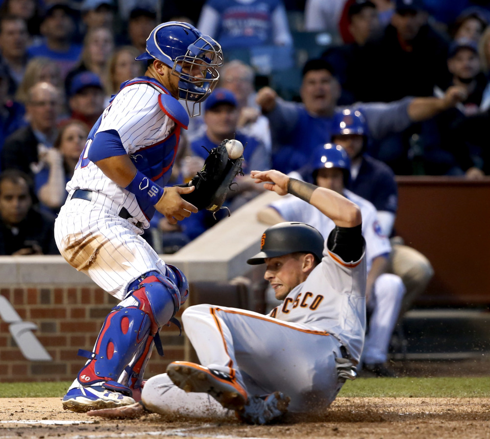 San Francisco's Joe Panik scores in front of Chicago Cubs catcher Willson Contreras during the third inning of a 6-4 win by the Giants Monday at Wrigley Field in Chicago.
