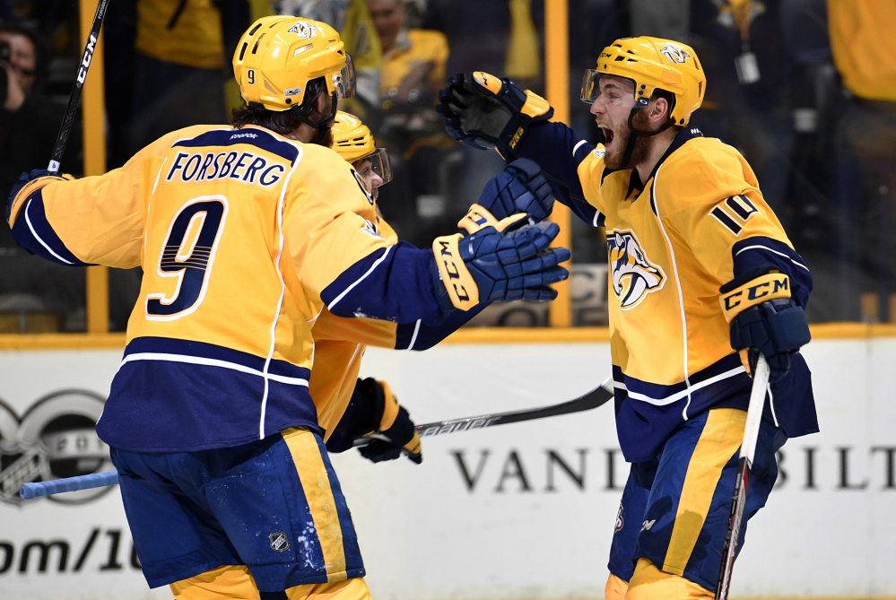 The Nashville Predators were in high spirits Monday night, as Filip Forsberg, left,  Pontus Aberg, center, and  Colton Sissons celebrate a third-period goal during a 6-3 win over the Anaheim Ducks to win the Western Conference Final at Nashville, Tenn., on Monday.