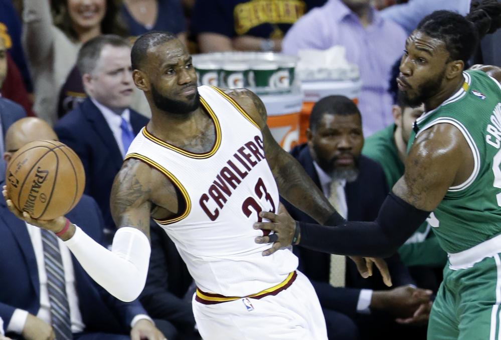 Cleveland's LeBron James, left, eventually put up 34 points on Jae Crowder, right, and the Boston Celtics during the Cavaliers' 112-99 victory Tuesday night in Game 4 of the Eastern Conference finals, but he had to work for it. James isn't anticipating any quit from the Celtics, despite a 3-1 series deficit.