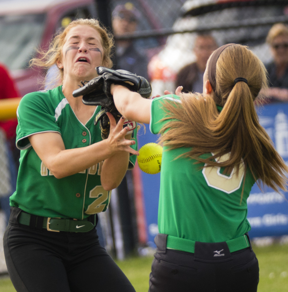 Olivia Ducharme, left, and Sarah Howe of Massabesic attempt to haul in an infield fly Wednesday during their SMAA softball game against undefeated Scarborough. The Red Storm ended the game with a nine-run sixth inning for a 13-1 victory at home.
