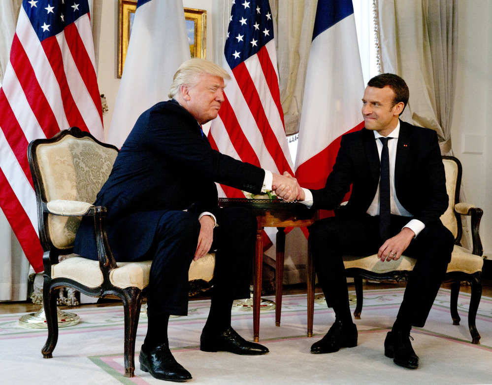 President Trump meets with French President Emmanuel Macron at the U.S. ambassador's residence in Brussels, Thursday for talks and an epic handshake.