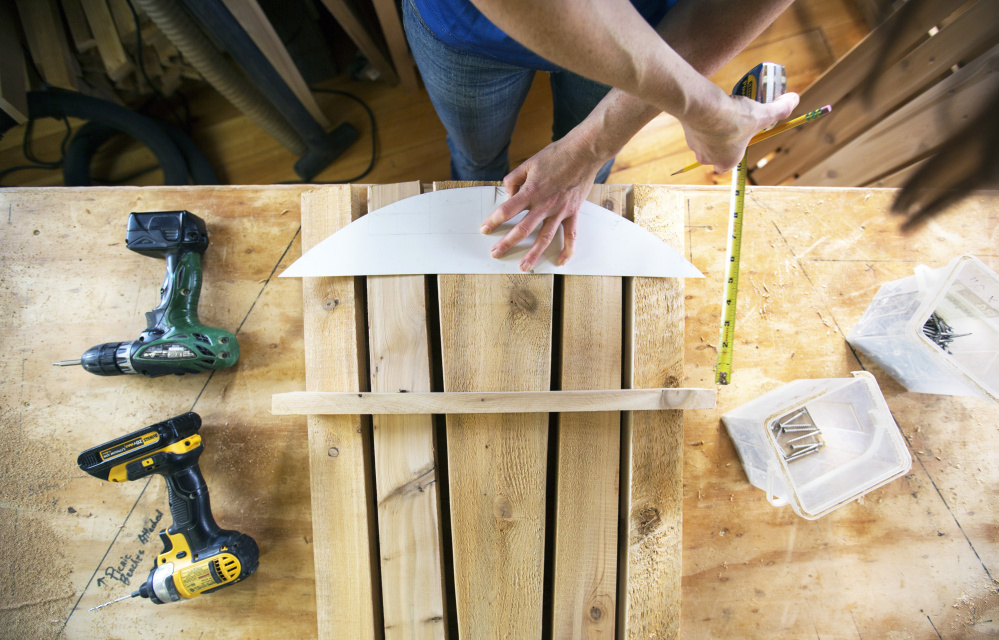 Amber Oberle Of Maine Adirondack Chairs Uses A Jigsaw To Shape The  Distinctive Rounded Top Of A Nearly Complete Adirondack Chair. Staff Photo  By Ben McCanna