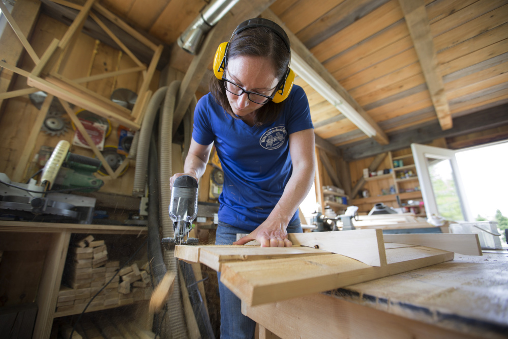 Amber Oberle Of Maine Adirondack Chairs Uses A Jigsaw To Shape The Distinctive Rounded Top Nearly Complete Chair Staff Photo By Ben Mccanna