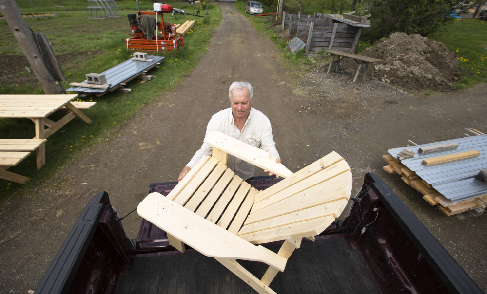 Amber Oberle of Maine Adirondack Chairs uses a jigsaw to shape the distinctive rounded top of a nearly complete Adirondack chair. Staff photo by Ben McCanna  sc 1 st  The Portland Press Herald & Whatu0027s the best Adirondack chair for your backyard lounging ...