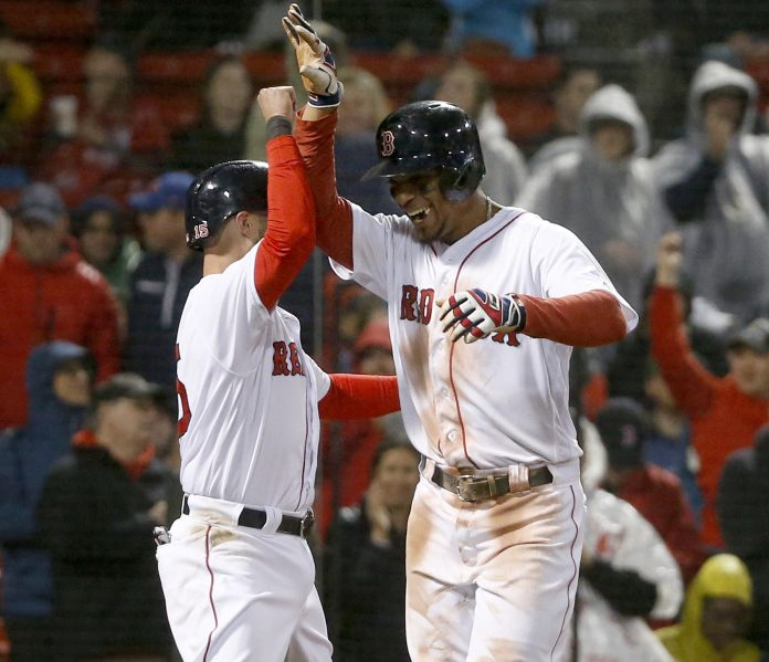 Boston's Xander Bogaerts, right, celebrates with Dustin Pedroia after hitting a two-run homer in the third inning Thursday night at Fenway Park.