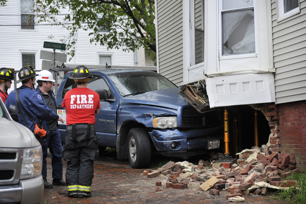 PORTLAND, ME - MAY 25: A pickup truck crashed into a building at High and Sherman streets in Portland on Friday, May 26, 2017. (Staff photo by Shawn Patrick Ouellette/Staff Photographer)