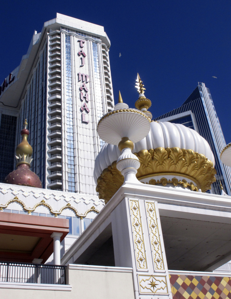 "This April 5, 2017 photo shows the exterior of the former Trump Taj Mahal casino, with the name ""Trump"" stripped from it,  in Atlantic City N.J. Hard Rock International is upping its investment in Atlantic City's former Trump Taj Mahal casino. Company chairman Jim Allen said Hard Rock will spend at least $500 million on rebranding and reopening the shuttered casino, up from its initial $350 million plan. Hard Rock bought the Taj Mahal in March for $50 million."