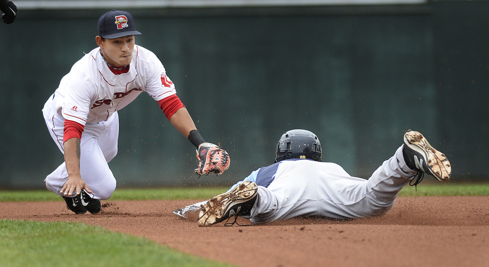 Sea Dogs shortstop Tzu-Wei Lin can't apply the tag in time as Trenton's Jake Cave slides in safely for a double Friday night at Hadlock Field. Trenton won, 8-6.
