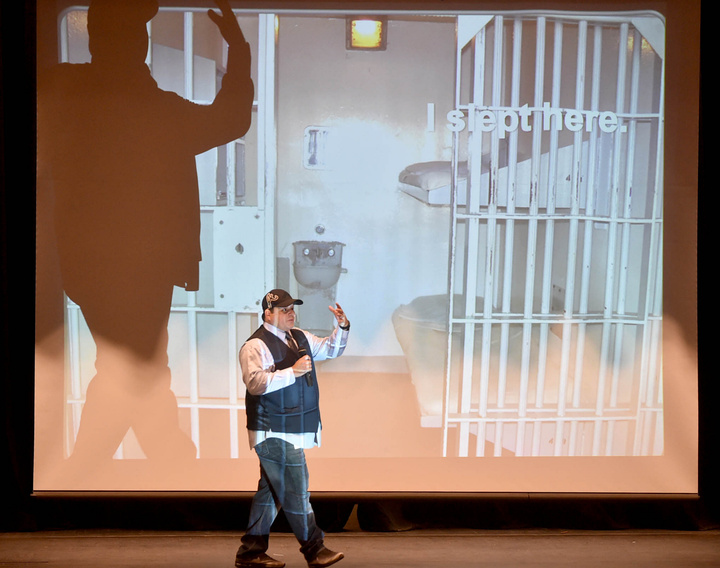 Chris Sandy talks Friday about his time in prison as he walks past a projection of the prison cell in which he lived in Georgia. Sandy, who gave a Choices Matter presentation at Waterville Senior High School, killed two people in an accident he caused while driving drunk.