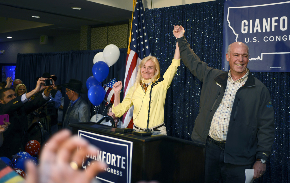 Greg Gianforte, right, and wife Susan, celebrate his win over Rob Quist for the open congressional seat at the Hilton Garden Inn Thursday night in Bozeman, Mont. Gianforte could face jail time and a fine if convicted of an assault charge.