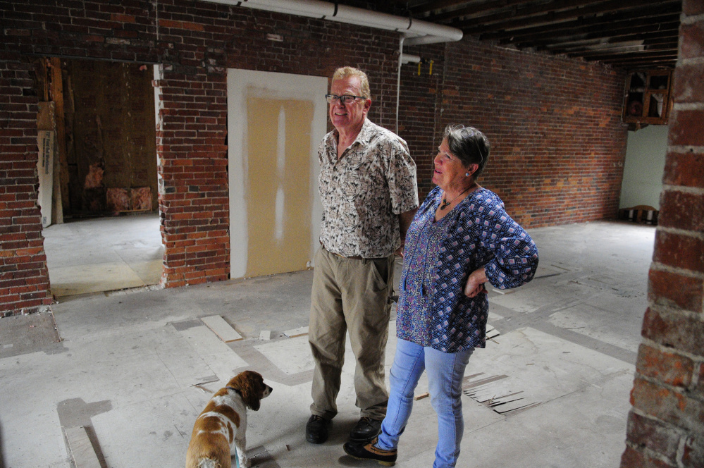 Mike Gent, left, and Cheryl Clark stand in the third floor studio on Thursday in their recently purchased building, the Milliken Block, in Gardiner.