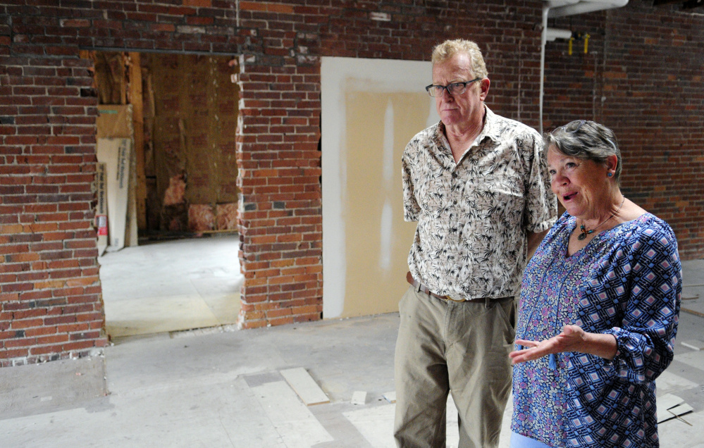 Mike Gent, left, and Cheryl Clark stand in the third floor studio Thursday in their recently purchased building, the Milliken Block, in Gardiner.