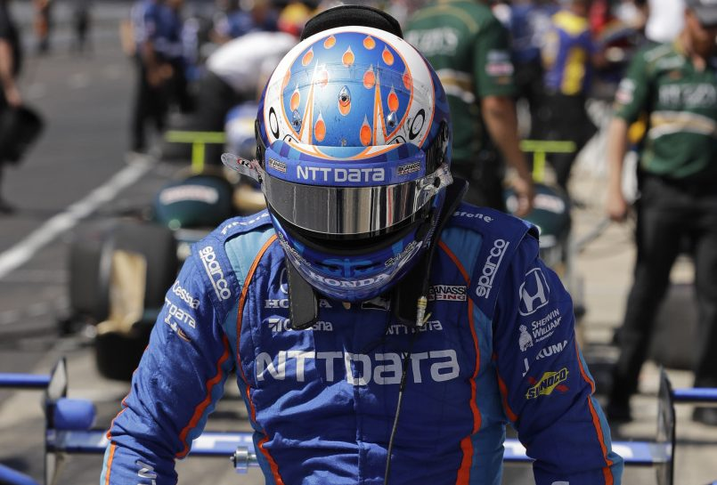 Scott Dixon of New Zealand posted the fastest qualifying time in 21 years at Indianapolis Motor Speedway. He will start from the pole for Sunday's Indianapolis 500. He won the race in 2008.