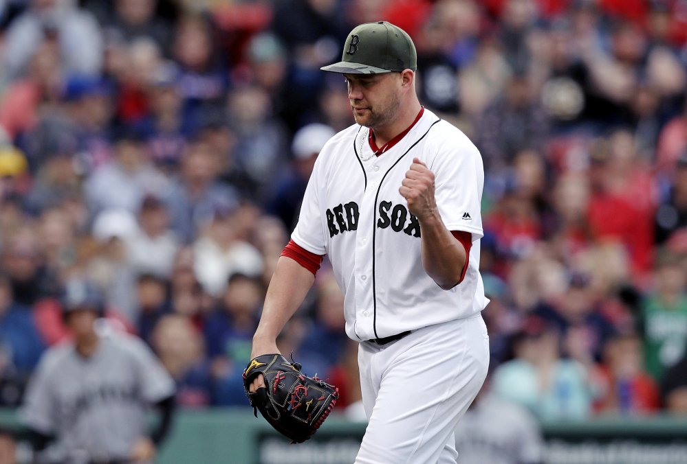 Boston starting pitcher Brian Johnson pumps his fist after completing the top of the eighth inning =against the Seattle Mariners at Fenway Park in Boston, Saturday. Johnson, who was called up from Pawtucket as a fill-in starter, threw a five-hit shutout.