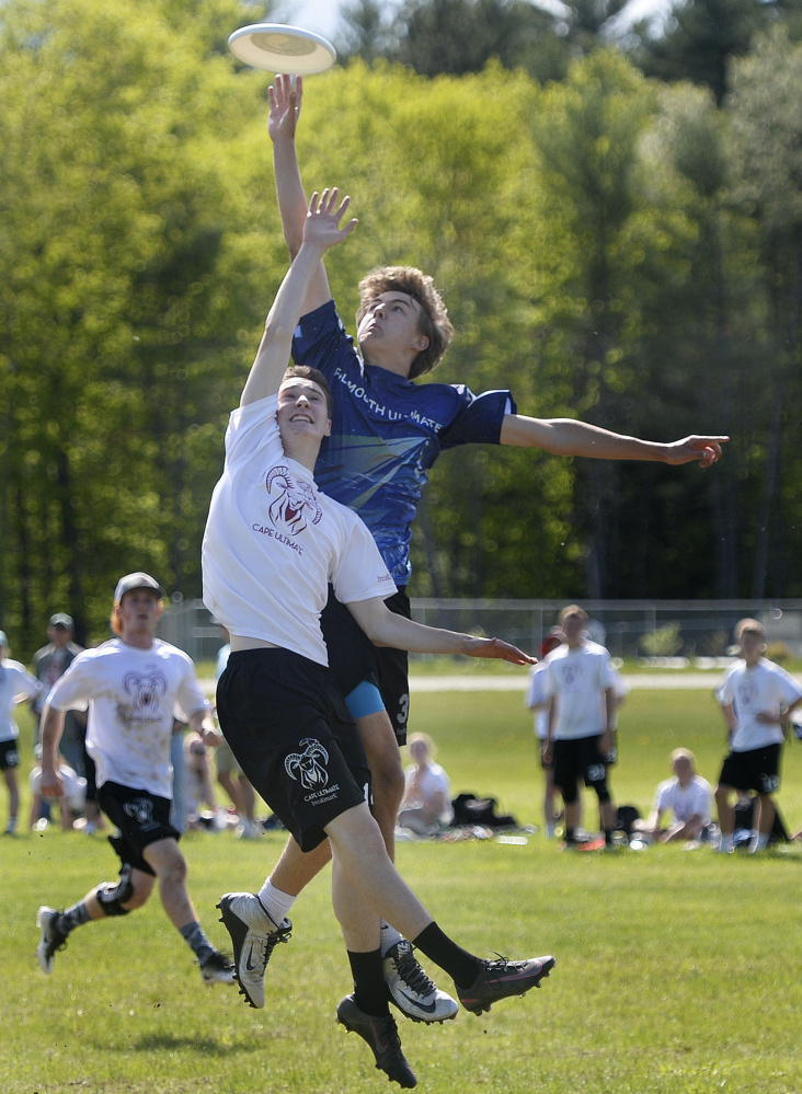 Cape Elizabeth's Calvin Stoughton, front, and Falmouth's Jack Hepburn go up for the disc during the boys' final. Falmouth captured its fourth straight championship, 15-8.