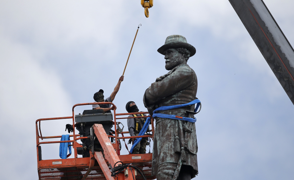 "Robert E. Lee's statue is taken down in New Orleans on May 19. Statues of Confederate leaders were put up ""to send a strong message ... about who was still in charge in this city,"" Mayor Mitch Landrieu said."