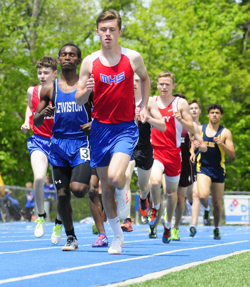 Messalonskee's Owen Concaugh leads the 1,600 meters at the Kennebec Valley Athletic Conference track and field championships Saturday at McMann Field in Bath.