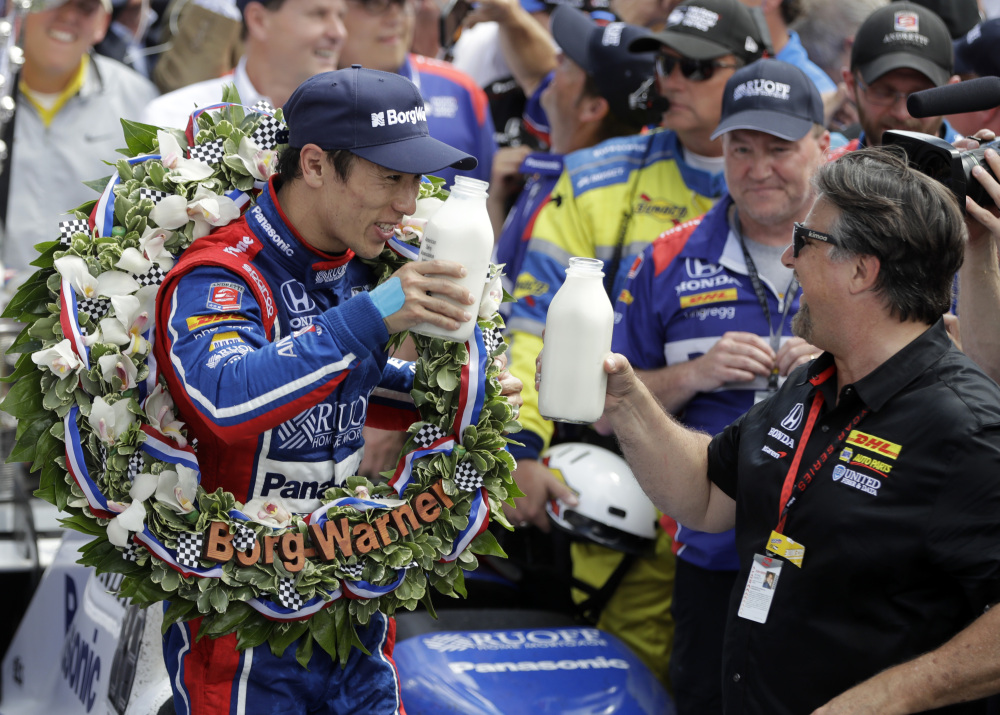 Takuma Sato, left, of Japan, toasts with car owner Michael Andretti as they celebrate after Sato won the Indianapolis 500 Sunday at Indianapolis Motor Speedway in Indianapolis.