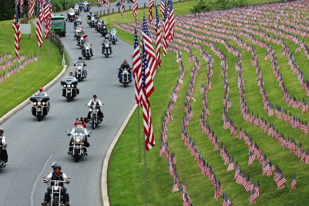 Motorcyclists ride into Indiantown Gap National Cemetery in Annville, Pa., for a Memorial Day weekend program.
