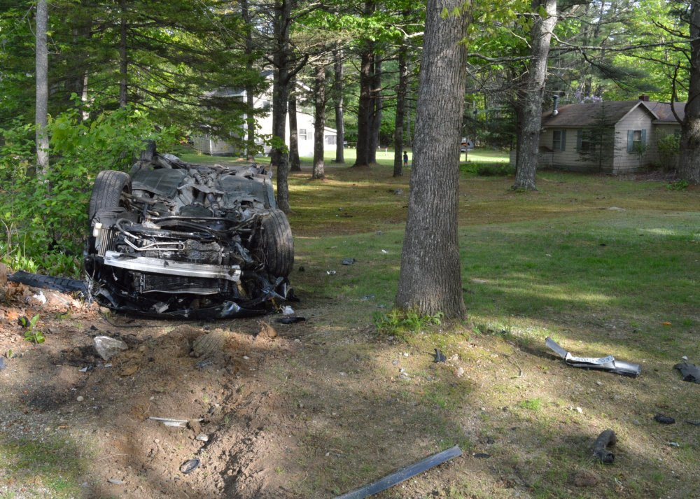 An Audi rests on its roof after its driver lost control in Standish on Sunday.