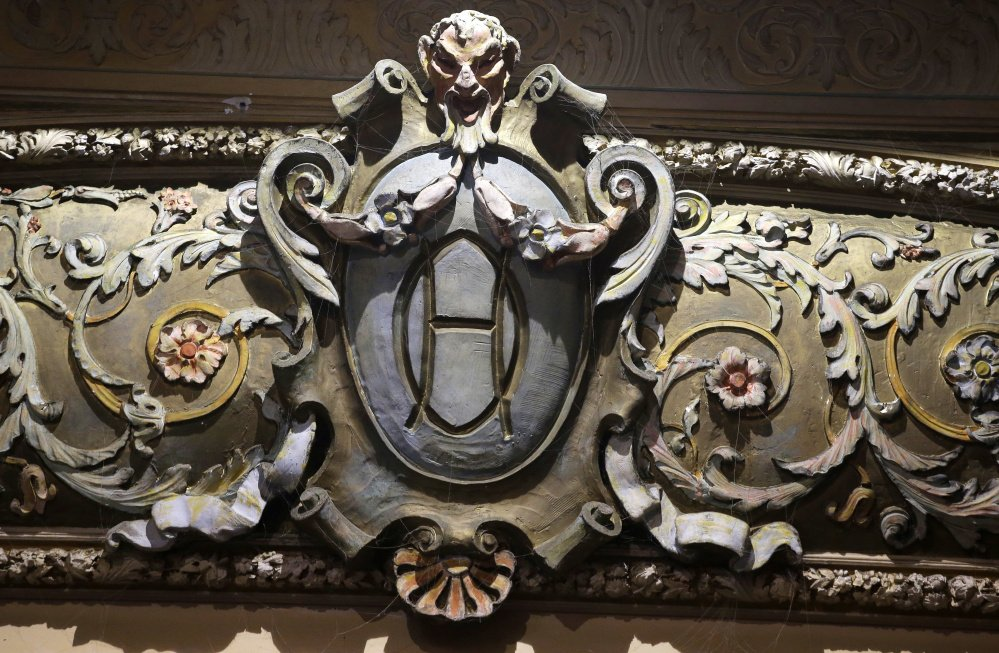 In this Tuesday, May 23, 2017 photo, an architectural detail rests on the proscenium arch in the Newport Opera House, in Newport, R.I. Vacant for years, the Newport Opera House is being restored and reopened. The nonprofit group that owns it hopes to make it into a centerpiece of live performance in the resort town already known for its jazz and folk festivals. (AP Photo/Steven Senne)