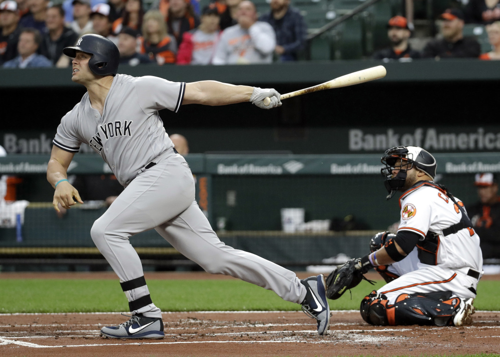 Matt Holliday of the Yankees watches the first of his two home runs Tuesday night against the Orioles in Baltimore. New York coasted to an 8-1 victory.