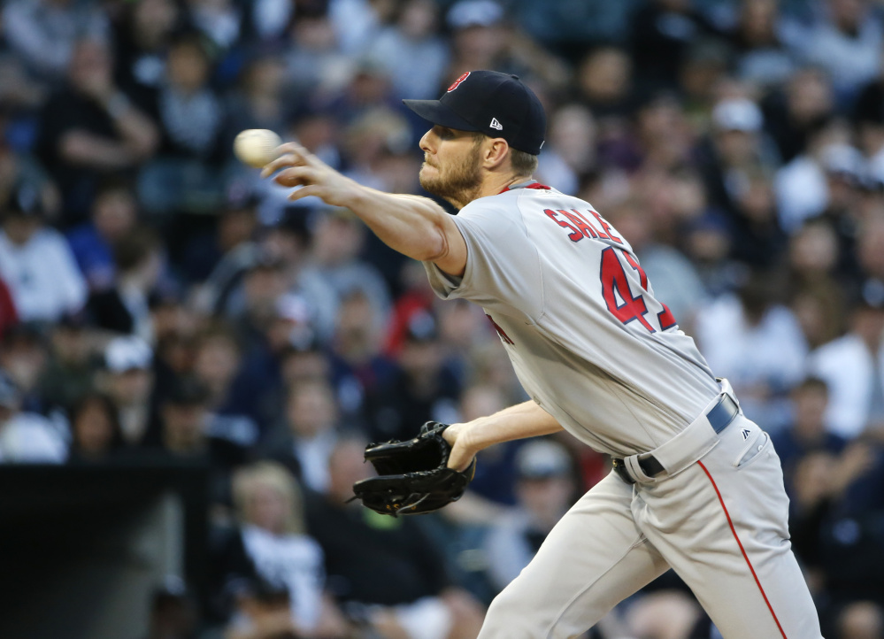 Red Sox starting pitcher Chris Sale allowed five earned runs in five innings in his first start against his former team, the Chicago White Sox, on Tuesday in Chicago. The Red Sox won 13-7.