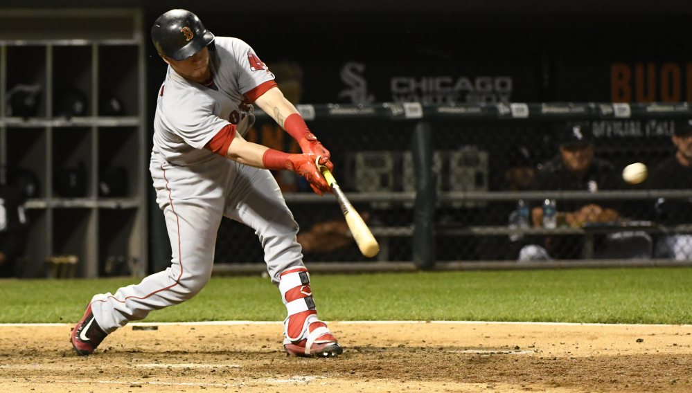Boston's Christian Vazquez hits an RBI double against the Chicago White Sox in the sixth inning Wednesday night in Chicago.