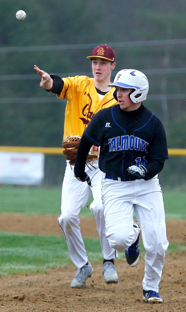 Falmouth's Cam Guarino runs back toward first base after getting stuck in a rundown. Cape Elizabeth shortstop Finn Bowe made the throw to Ryan Weare, who tagged Guarino out. Guarino fared much better on the mound, throwing a no-hitter.